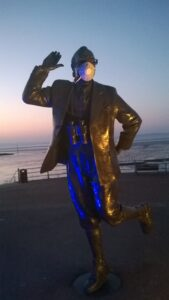 """Entry no. 3 """"Untitled"""": I took this photograph in March/April 2020 ,The Eric Morecambe Statue with the mask on, i think speaks volumes for the """"Corona covid 19"""" crisis we are all in."""